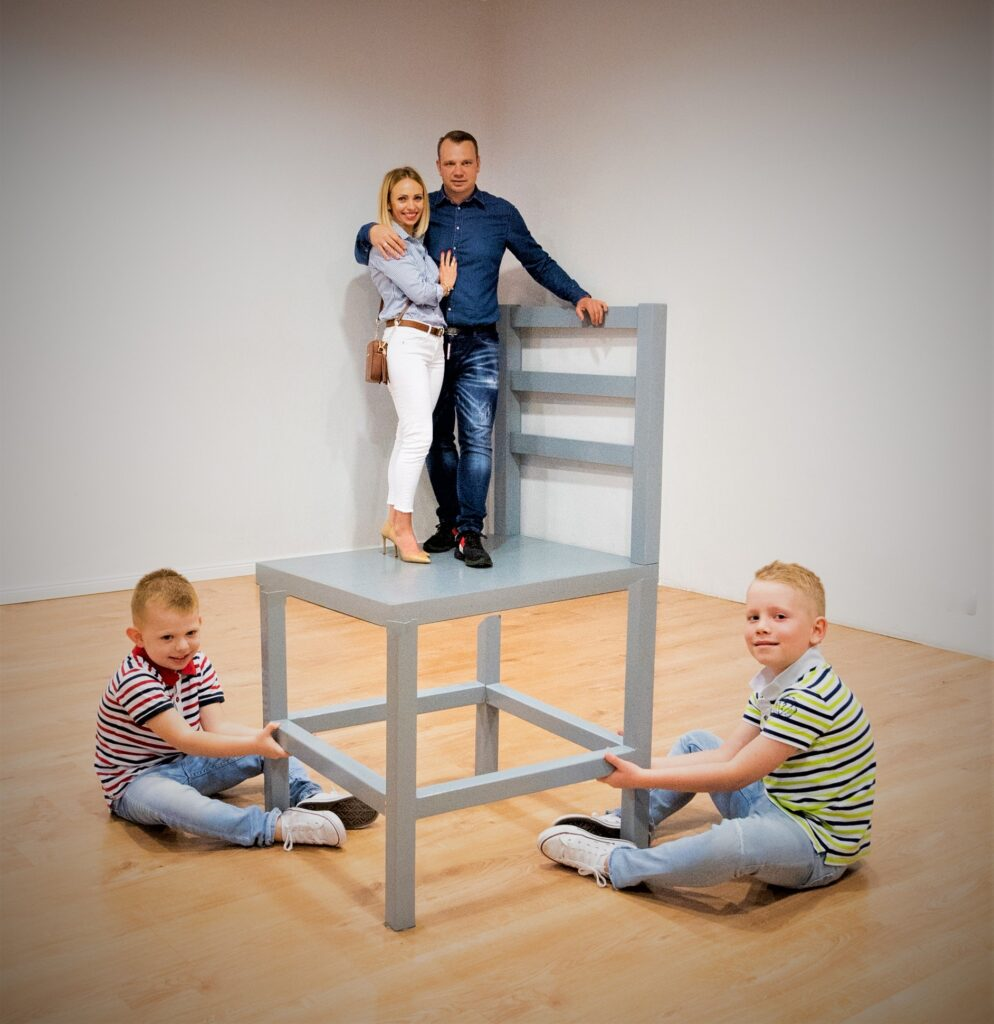 Family playing with optical illusion